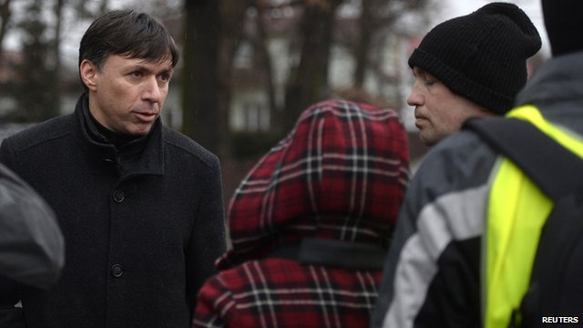 Patrik Kuncar (L), mayor of Uhersky Brod, speaks with a citizen near a restaurant where a gunman opened fire ion 24 February 24