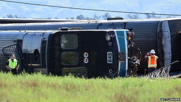 Investigators inspecting overturned carriages