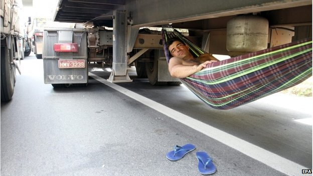 Lorry driver sleeping during a road block in Minas Gerais