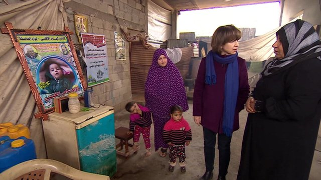 BBC correspondent Lyse Doucet with woman whose baby grandson froze to death in Gaza