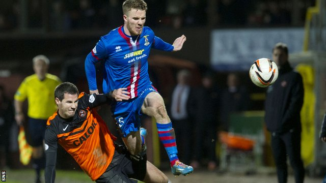Marley Watkins tries to escape the attentions of Ryan McGowan
