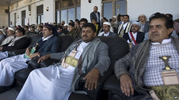 President of the Supreme Revolutionary Committee, Mohammed Ali al-Houthi (centre) attends a rally in support of the Houthis at a sports stadium in Sanaa, Yemen (7 February 2015)
