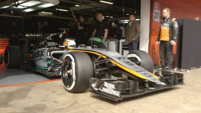 Nico Hulkenberg leaves his garage in Force India's new 2015 car