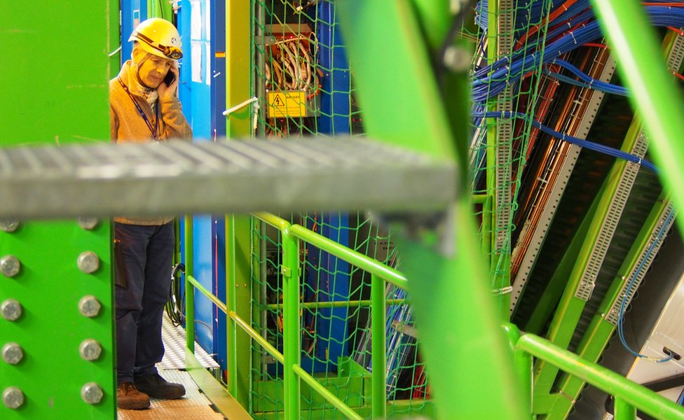 LHC team member on the phone