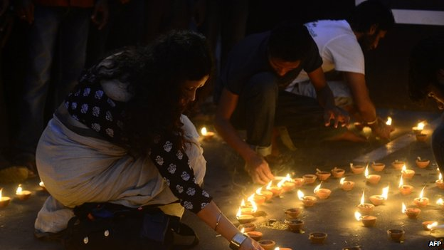 Bangladeshi secular activists light candles during a protest against the killing of Mr Roy