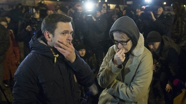 Russian opposition leaders Ilya Yashin, left, and Ksenia Sobchak react to news of the death of Mr Nemtsov - 27 February 2015