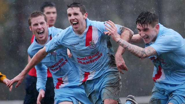 Gary Thompson celebrates his injury-time winner for Ballymena United against Harland & Wolff Welders in the Irish Cup