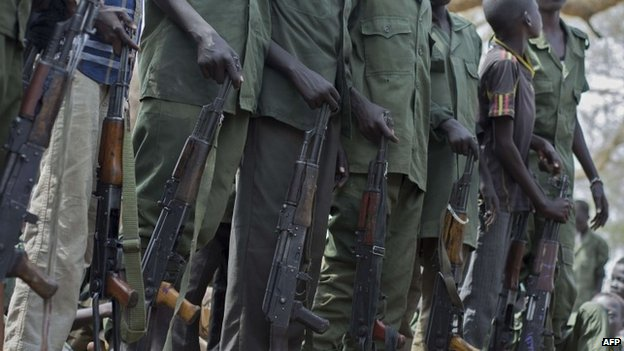 Child soldiers prepare to lay down their arms at a ceremony in South Sudan