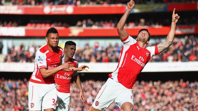 Olivier Giroud celebrates after scoring for Arsenal against Everton