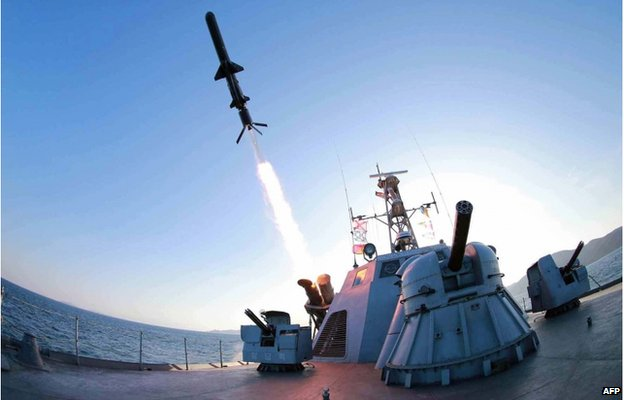 """This undated picture released from North Korea's official Korean Central News Agency (KCNA) on 8 February 2015 shows the test-firing of a new type of """"anti-ship rocket"""", to be equipped at Korean People's Army (KPA) naval units, at an undisclosed location at sea off North Korea."""