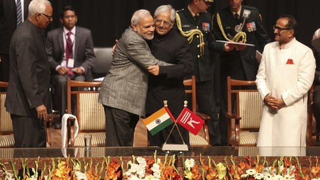 Indian PM Narendra Modi greets Mufti Mohammed Sayeed after the later was sworn in as the chief minister of Jammu and Kashmir on March 1, 2015