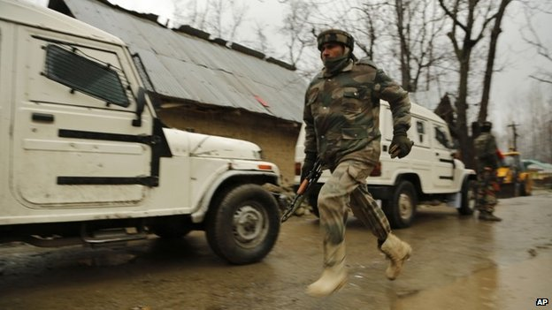 An Indian army soldier runs to get an ambulance after a colleague is injured during clashes with suspected rebels in Kashmir on Feb 25, 2015