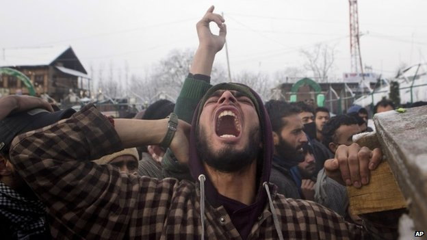 A Kashmiri Muslim villager shouts during the funeral procession of a suspected rebel Kashmir on Feb 26, 2015