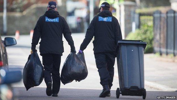 Police continue their investigations outside properties in Barton Court
