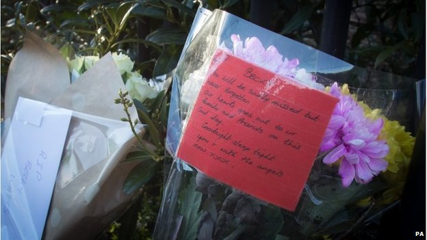 Floral tribute message - from flowers left outside the house where the body parts were discovered in Barton's Court