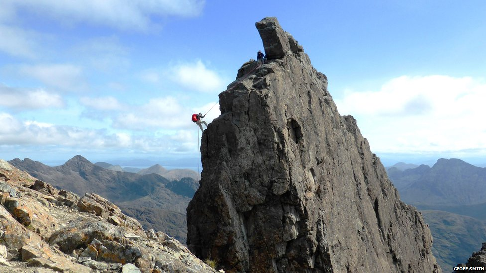 A climber abseiling off the Inaccessible Pinnacle