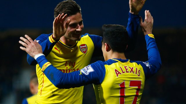 Arsenal forward Oliver Giroud celebrates with Alexis Sanchez after the Chilean scores against Queens Park Rangers
