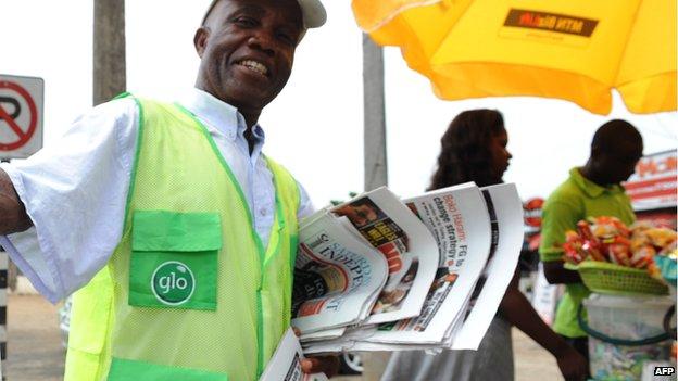 A newspaper vendor in Nigeria in 2013