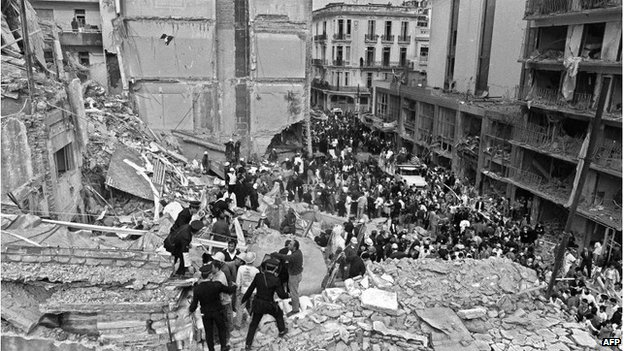 Police and rescuers in the wreckage of the Amia building in Buenos Airea, July 1994