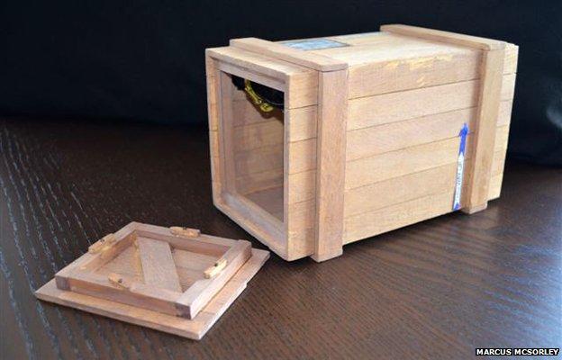 A replica of the box