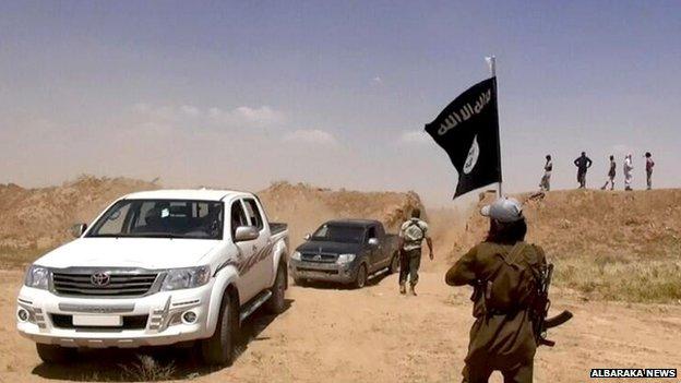 Islamic State militants on the Iraq-Syria border