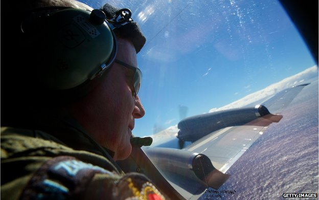 SGT Trent Wyatt, a crew member of a Royal New Zealand Air Force P-3 Orion, on lookout during the search to locate missing Malaysia Airways Flight MH370 at sea over the Indian Ocean on April 11, 2014