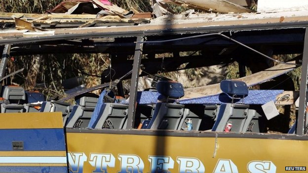 The wreckage of a bus believed to be carrying Lebanese Shia Muslim pilgrims in Damascus which the Nusra Front claimed responsibility for bombing (01 February 2015)