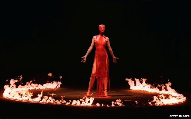 Erin O'Connor surrounded by a ring of fire at McQueen's autumn 1998 show