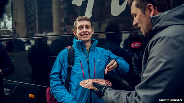 man being handed plates of tapas