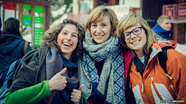 three female tourists smiling
