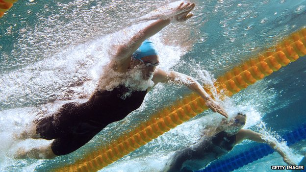 This picture taken with an underwater camera shows Camille Muffat (top) on her way to win the women's 200m freestyle final on April 12, 2012