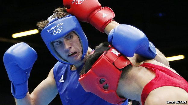 Tuvshinbat Byamba (R) of Mongolia defends against Alexis Vastine (L) of France during their round of 16 Welterwight (69kg) match of the London 2012 Olympic Games at the ExCel Arena on August 3, 2012