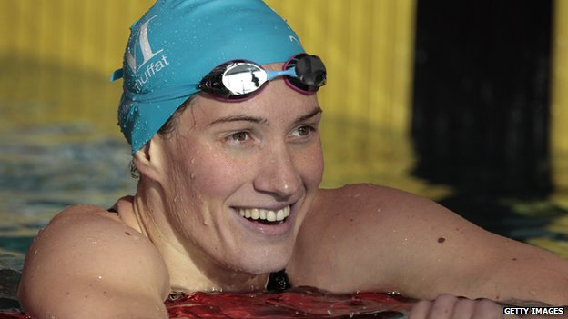 French swimmer Camille Muffat reacts after winning the women's 200m freestyle final heat of the French swimming championships in Chartres. 12 April 2014
