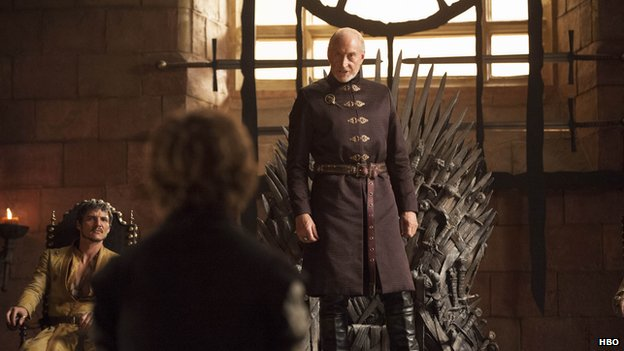 Tywin Lannister stands in the Throne Room