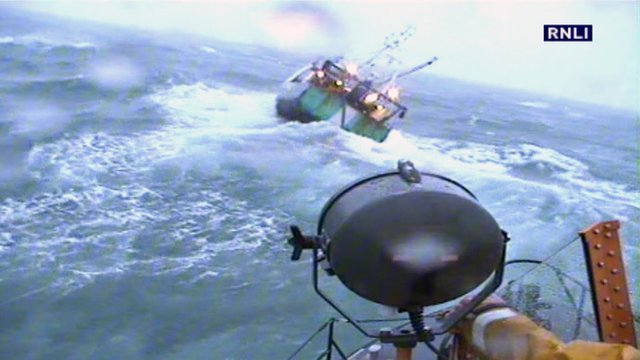 RNLI lifeboat going to rescue a trawler