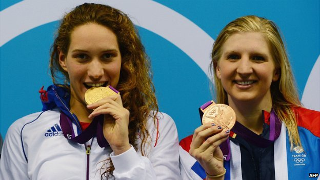 Camille Muffat (left) with her gold medal after winning the women's 400m freestyle at the London 2012 Olympics, in which British swimmer Rebecca Adlington (right) took bronze - 29 July 2012