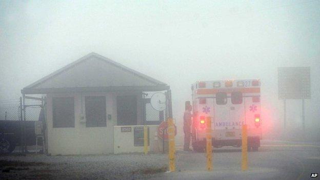 An Okaloosa County ambulance sits at the Eglin Air Force entrance in Fort Walton Beach, Florida 10 March 2015