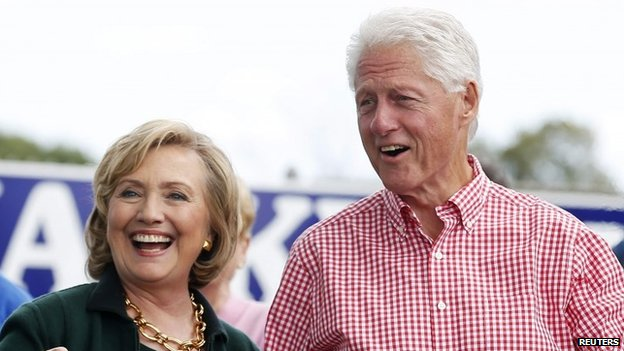 Former U.S. Secretary of State Hillary Clinton and her husband former U.S. President Bill Clinton hold up some steaks at the 37th Harkin Steak Fry in Indianola, Iowa, 14 September 2014