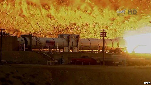 Nasa rocket booster during test-firing in Utah desert