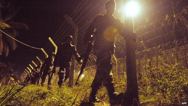 Sri Lankan soldiers patrol, late February 20, 2009 at Katunayake, near the international airport