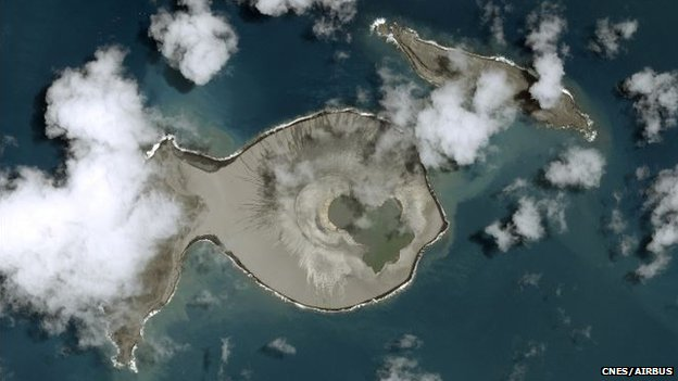 Satellite image showing two islands and large crater