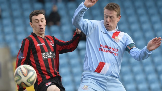 Paul Heatley of Crusaders in action against Ballymena's Allan Jenkins