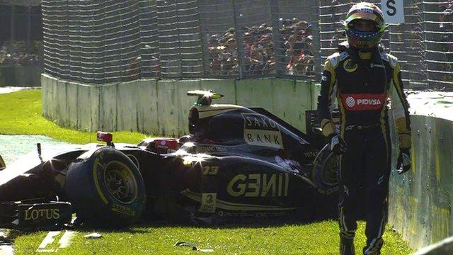 Pastor Maldonado walks away from his stricken Lotus