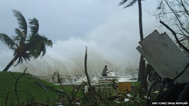 A man runs away form high waves caused by Cyclone Pam along the coast of Vanuatu capital Port Vila (image supplied by Care Australia)