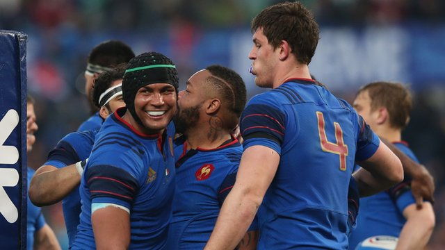 French players surround Mathieu Bastareaud to congratulate him on his late try in Rome