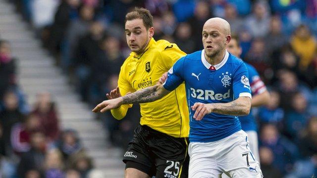 Livingston's Scott Pittman chases Rangers midfielder Nicky Law