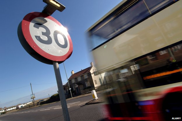 Bus passes 30mph speed limit sign