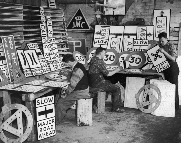 Signwriters prepare 30mph signs in 1935