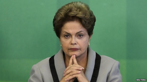 """Brazil""""s President Dilma Rousseff reacts to press questions on corruption scandal and demos during the signing ceremony of the Civil Procedure Code at the Planalto Palace in Brasilia"""