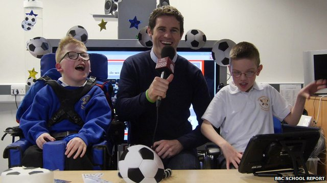 Kevin Kilbane works with School Reporters Ben and Sam